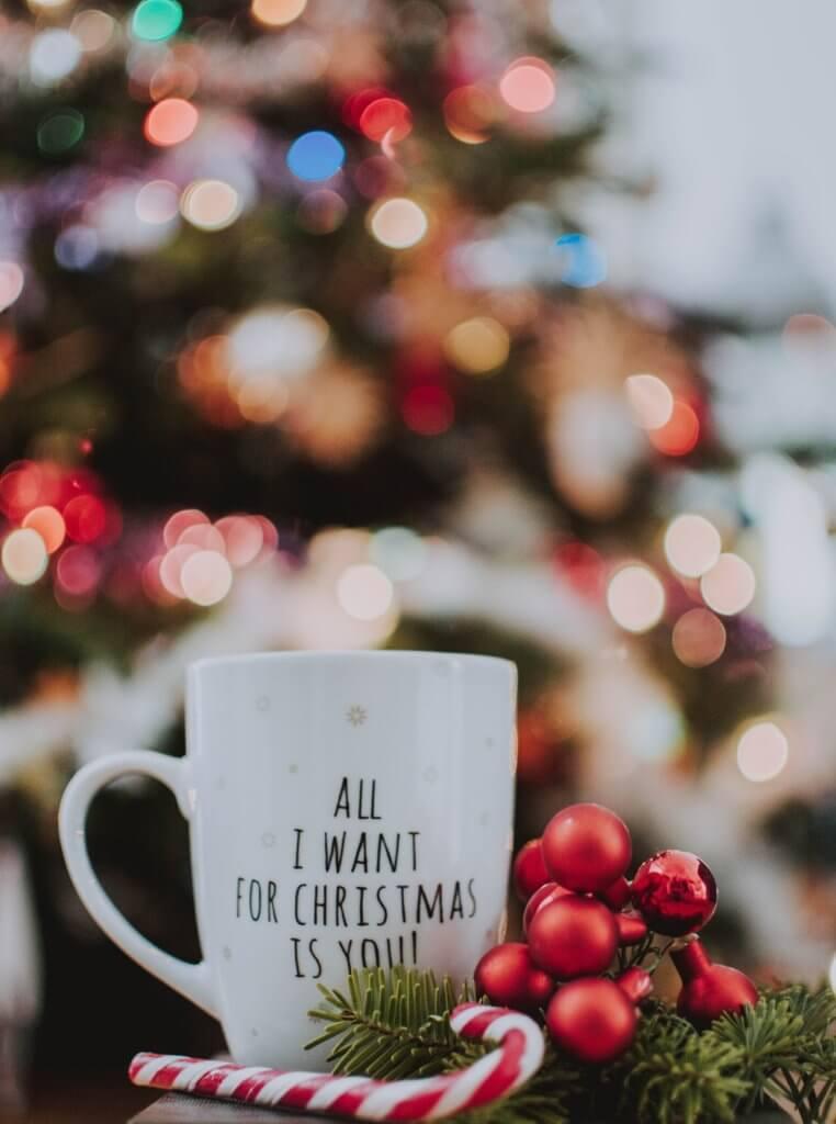 a mug with printed christmas text