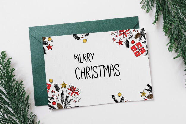 "a greeting card with ""Merry Christmas"" written on it"