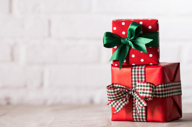 two red gift boxes with different ribbon designs