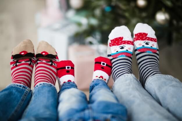 three pairs of socks with christmas printed designs